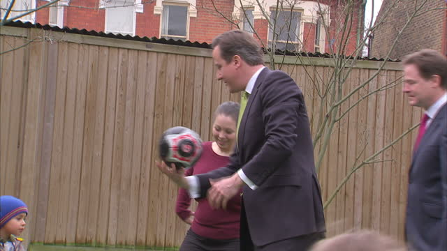 stockvideo's en b-roll-footage met david cameron and nick clegg milling in playground w/ toddlers playing during tour of nursery david cameron and nick clegg visiting nursery on march... - wandsworth