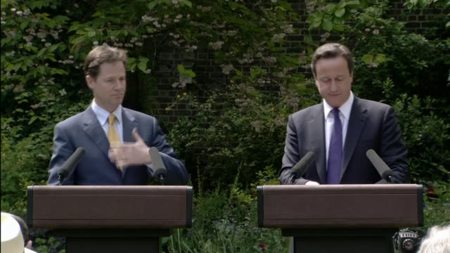 david cameron and nick clegg rose garden press conference; cameron press conference sot - this is a five year arrangement, what we find so exciting,... - politics and government stock videos & royalty-free footage
