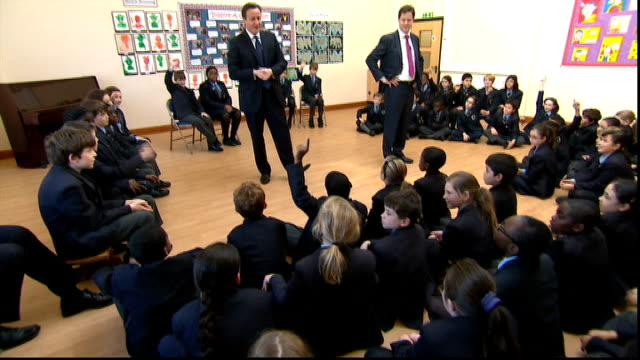 david cameron and nick clegg visit brixton school q when you were a child what did you want to be one time wanted to join army then lorry driver... - schulleiter stock-videos und b-roll-filmmaterial