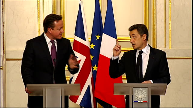 David Cameron and Nicolas Sarkozy pledge closer cooperation Paris Elysee Palace INT Side shot of Sarkozy and Cameron at press conference podiums...