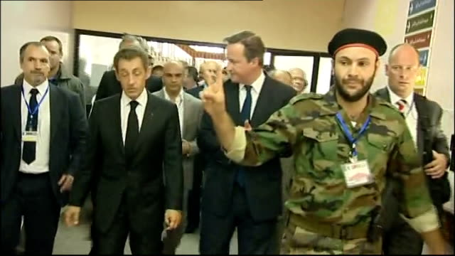 david cameron and nicolas sarkozy visit: arrival in tripoli / hospital visit; int arrival of sarkozy and cameron at hospital shaking hands with... - shaky stock videos & royalty-free footage
