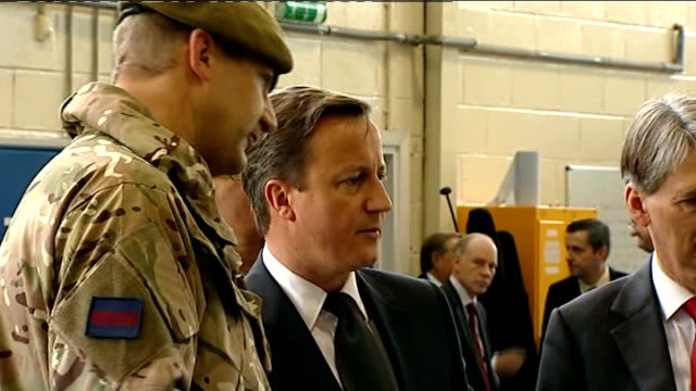 david cameron and philip hammond visit raf base in bedford / cameron interview; england: bedfordshire: bedford: int david cameron mp meeting soldiers... - head up display parte di veicolo video stock e b–roll