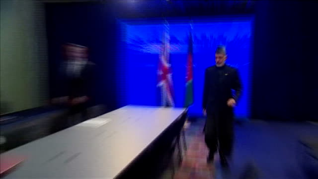 stockvideo's en b-roll-footage met david cameron and president karzai at nato meeting usa chicago photography*** general views of david cameron mp and president hamid karzai handshake... - william hague