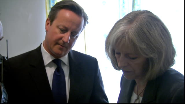 David Cameron and Theresa May visit house where immigration raid took place in Slough ENGLAND Berkshire Slough EXT David Cameron MP and Theresa May...