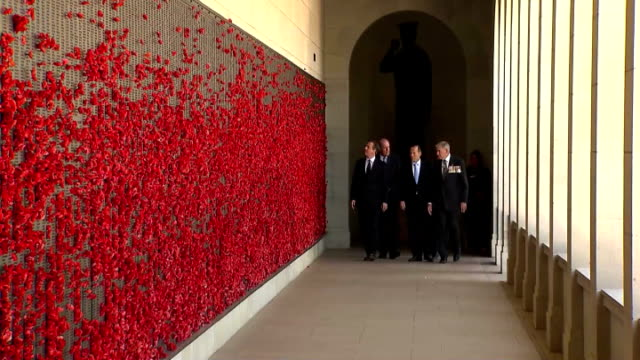 David Cameron and Tony Abbott visit Australian War Memorial AUSTRALIA Canberra EXT Motorcade along / David Cameron MP and Tony Abbott up steps with...