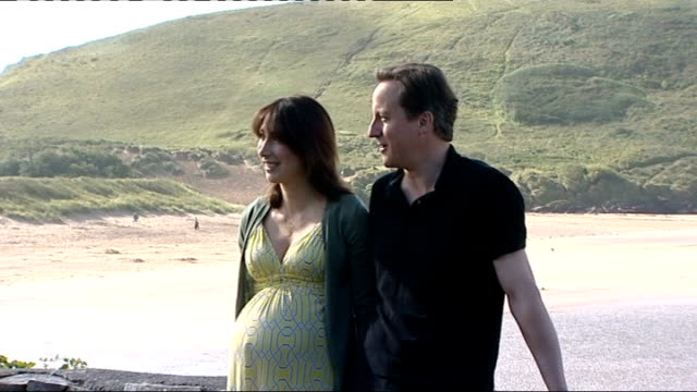 stockvideo's en b-roll-footage met david cameron and wife take summer holiday in cornwall england cornwall daymer bay ext various shots david cameron mp and pregnant wife samantha... - mp