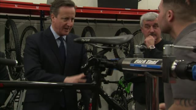 david cameron announces prison reforms; warwickshire: rugby: hmp onley: david cameron mp being shown 'halfords academy' bicycle workshop various of... - prisoner education stock videos & royalty-free footage