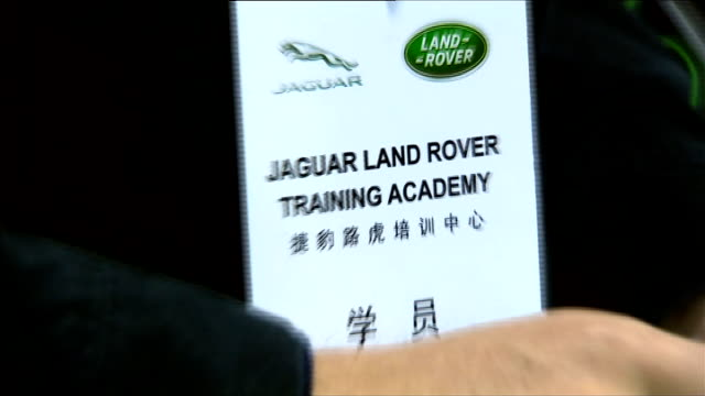 david cameron arrival in beijing int david cameron asking land rover employee about what's selling best / cameron talking to worker stood by car with... - sales pitch stock videos & royalty-free footage