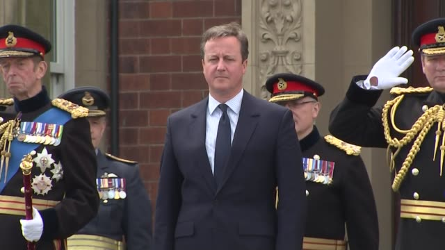 david cameron attends armed forces day david cameron chatting with military officers / david cameron and others stand for ceremony / marching band... - music stand stock videos and b-roll footage