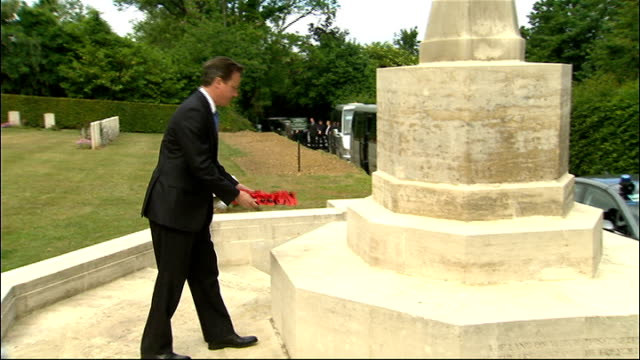 david cameron attends g8 summit calvados tourgeville military cemetery ext david cameron mp lays wreath at war memorial - calvados stock videos and b-roll footage