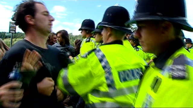 Balcombe protests continue ENGLAND West Sussex Balcombe EXT Various of police officers pushing back group of antifracking protesters in road who try...