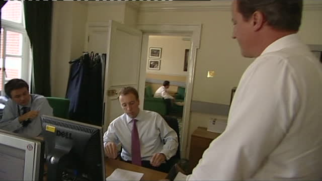 """david cameron, before he became prime minister, chatting with a young matt hancock, before he was a mp, in his parliamentary office - """"bbc news"""" stock videos & royalty-free footage"""