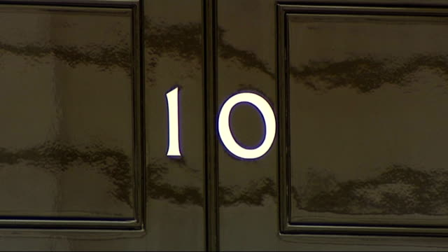 david cameron begins cabinet reshuffle / george osborne booed at paralympics downing street olympic bunting hanging outside number 10 number '10' on... - hanging stock videos & royalty-free footage