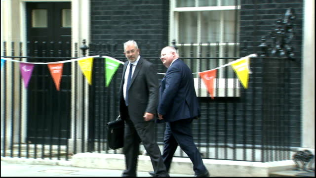 david cameron begins cabinet reshuffle / george osborne booed at paralympics; downing street: eric pickles mp and unidentified man leaving number 10... - 内閣改造点の映像素材/bロール