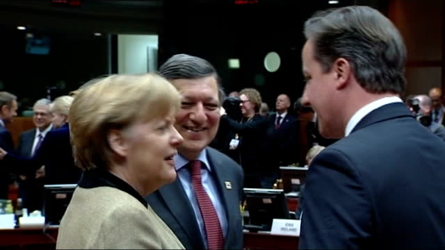 david cameron defends decision not to block eu veto lib brussels photography*** david cameron mp greeting angela merkel with kisses on each cheek and... - cheek to cheek stock videos & royalty-free footage