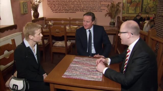 david cameron drinks beer with his czech counterpart bohuslav sobotka; czech republic: prague: ext **beware flash photography** david cameron mp... - lager stock videos & royalty-free footage