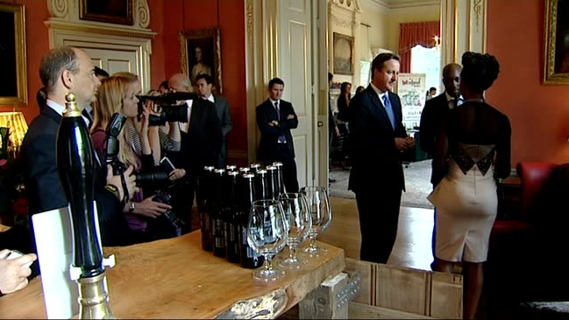 David Cameron holds reception for British entrepreneurs David Cameron talking to entrepreneurs from Suffolk and looking at their objects on display...