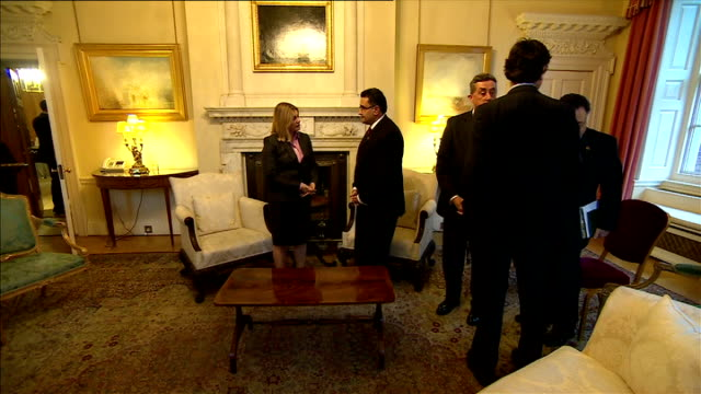David Cameron hosts Afghanistan mining meeting at Downing Street ENGLAND London 10 Downing Street INT David Cameron MP and Justine Greening MP seated...