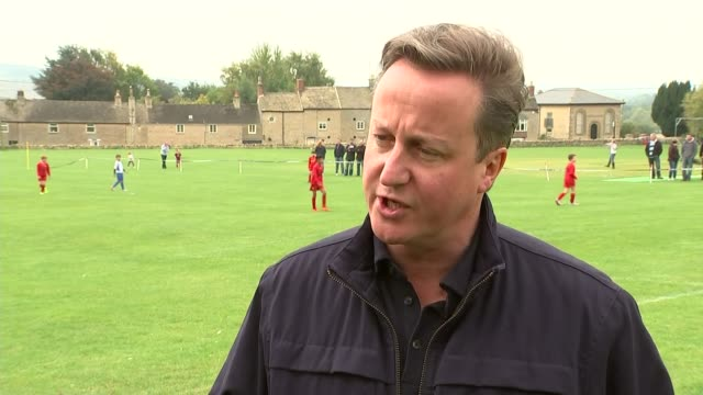 David Cameron interview and watching football with Samantha Cameron ENGLAND Oxfordshire Chadlington EXT David Cameron MP interview SOT It's vitally...