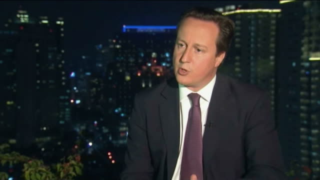 david cameron interviewed on tax changes while in indonesia; cameron interview sot re no planes flying from jakarta to london: - there are plans for... - no doubt band stock videos & royalty-free footage