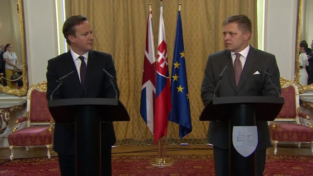 david cameron joint press conference with slovak prime minister robert fico; slovakia: bratislava: int david cameron mp and robert fico shake hands... - osteuropäische kultur stock-videos und b-roll-filmmaterial