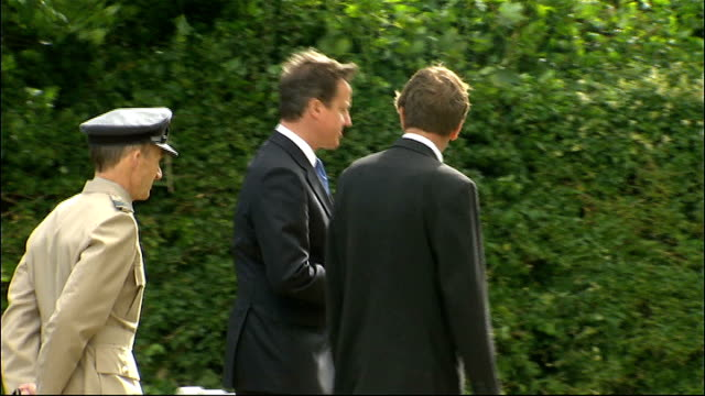 david cameron lays wreath at tourgeville military cemetery france calvados tourgeville military cemetery ext david cameron mp arriving at cemetery... - calvados stock videos and b-roll footage