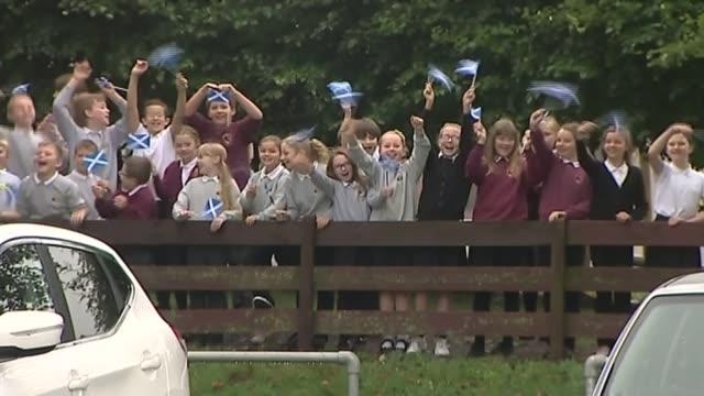 Legacy DATE Scottish school children waving Saltire flags during Scottish Independence referendum
