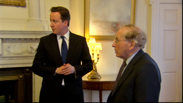 david cameron meets auschwitz survivor and signs book of commitment david cameron posing at desk with book of commitment / cameron standing chatting... - signierstunde stock-videos und b-roll-filmmaterial
