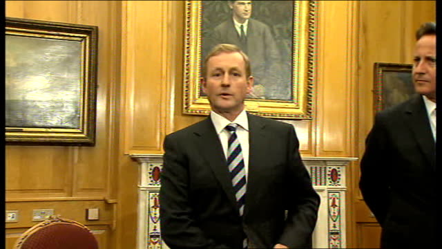 david cameron meets enda kenny at government buildings; int **beware flash photography** cameron and kenny entering room and cameron signing book /... - politics and government stock videos & royalty-free footage
