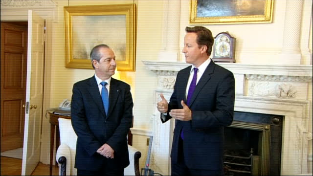 vídeos de stock, filmes e b-roll de david cameron meets maltese pm; england: london: downing street: int david cameron mp and lawrence gonzi into room and shake hands david cameron mp... - prime minister