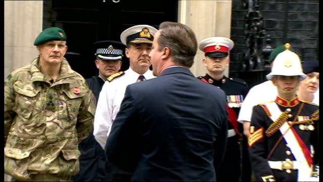 david cameron meets royal marines at downing street; back view cameron speaking to royal marines / soldiers along - 英国海兵隊点の映像素材/bロール