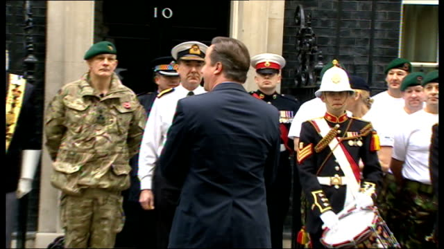 david cameron meets royal marines in downing street; england: london: downing street: ext david cameron mp along and addresses a group of a group of... - royal marines stock videos & royalty-free footage