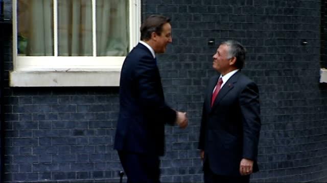 David Cameron meets the King of Jordan at Downing Street ENGLAND London Downing Street EXT King Abdullah II of Jordan out of car and along to shake...