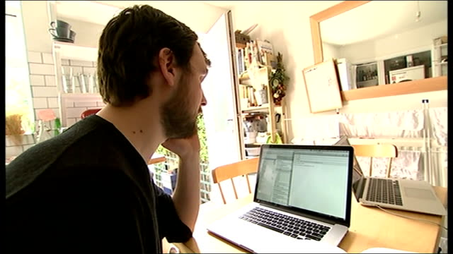 David Cameron offers help in search for missing man Gareth Huntley ENGLAND Leeds INT Setup shots of Mark Huntley working at laptop computer and...