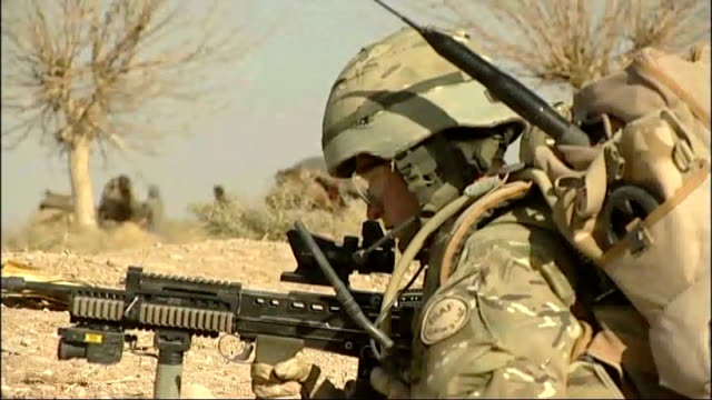 david cameron outlines further troop reductions in afghanistan; date unknown afghanistan: helmand province: ext british soldiers along on foot patrol... - marschieren stock-videos und b-roll-filmmaterial