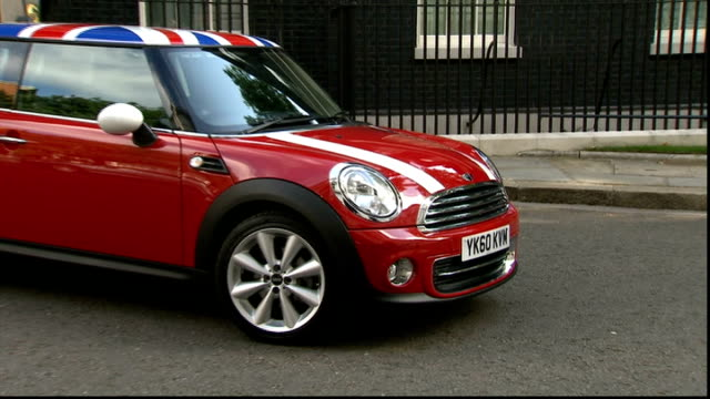david cameron photocall with mini car and bmw representatives outside number 10 england london downing street ext general views of mini car with... - 自動車ブランド mini点の映像素材/bロール