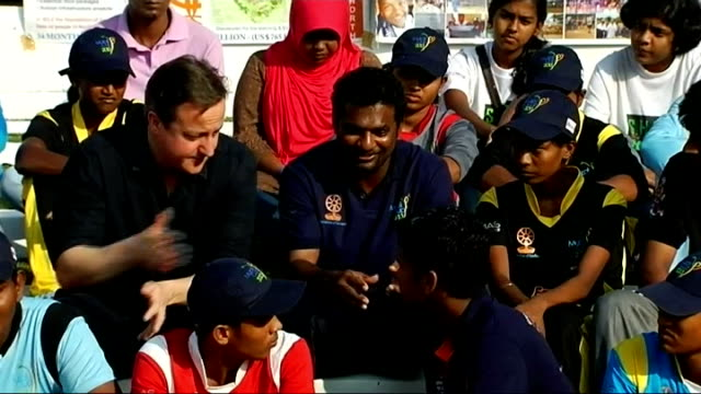 David Cameron plays cricket and talks to Tamils EXT Cameron sitting with Muralitharan and young cricketers