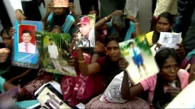 david cameron plays cricket and talks to tamils lib jaffna ext gvs of distressed women protesters holding up photographs of missing relatives poster... - missing poster stock videos & royalty-free footage