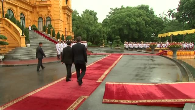 david cameron pm arrives at presidential palace in hanoi vietnam hanoi photography*** david cameron mp out of car and is greeted by vietnamese pm... - vietnamese military stock videos & royalty-free footage