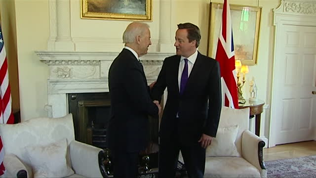 david cameron pm meets with us vice president joe biden at downing street, handshake and photocall, 2013 - 2013 stock videos & royalty-free footage
