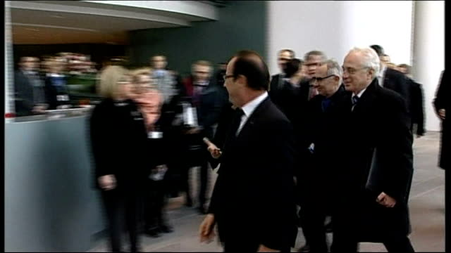 David Cameron prepares to deliver Europe speech GERMANY Berlin PHOTOGRAPHY *** Angela Merkel and Francois Hollande along on red carpet to meeting to...