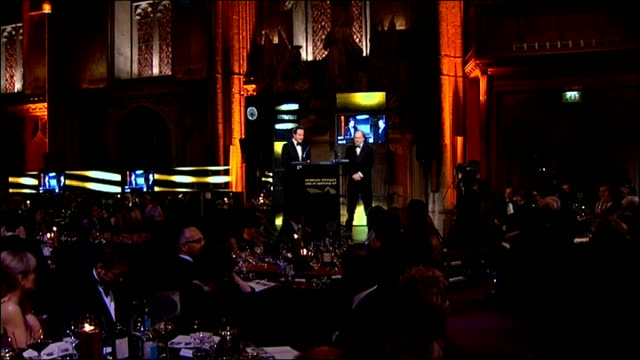 david cameron presents margaret thatcher with a lifetime achievement award; cameron shaking hands with anderson / cameron and anderson engage in... - 生涯功労賞点の映像素材/bロール