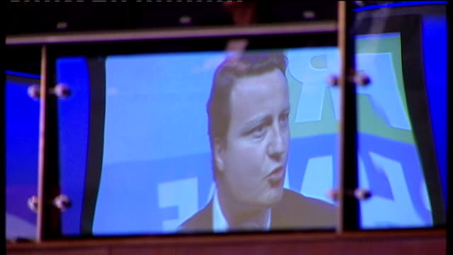 david cameron promises to lead government of thrift gloucestershire cheltenham reflection of cameron in glass balcony as makes speech - david bond stock videos & royalty-free footage