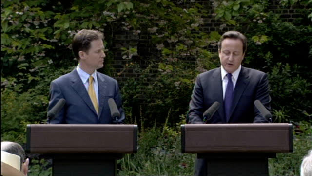 david cameron promises voters a 'real choice' on europe ahead of coalition midterm review lib london downing street rose garden ext david cameron mp... - david cameron politiker stock-videos und b-roll-filmmaterial