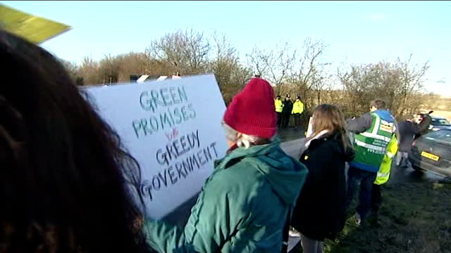 vídeos de stock e filmes b-roll de david cameron promotes shale gas offer to local councils councillor colin davey setup shot with reporter / interview sot group of protesters chanting... - bare tree