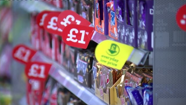 david cameron rejects calls for sugar tax int chocolate bars on shelves in supermarket aisle selling chocolate and sweets in supermarket customer... - ware stock-videos und b-roll-filmmaterial