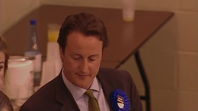 vídeos de stock e filmes b-roll de david cameron resigns as an mp; file: 2001 int david cameron wearing blue conservative rosette at election results general view votes being counted... - mp