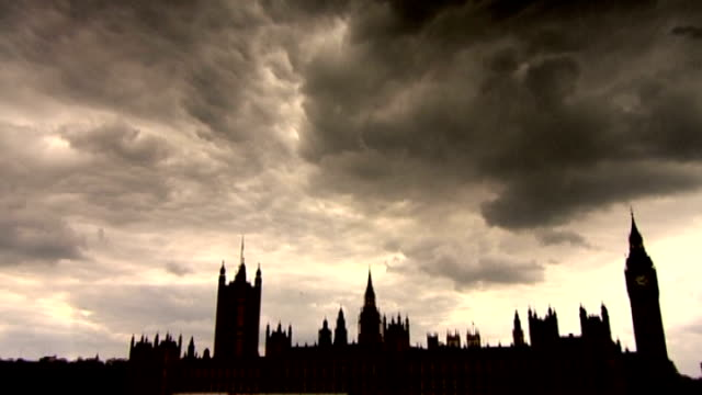 david cameron responds to critics in mail on sunday article date ext various shots of silhouette of houses of parliament with clouds overhead - article stock videos and b-roll footage