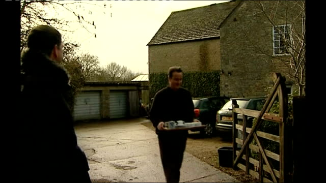 david cameron responds to drug allegations oxfordshire dean cameron towards from house with tray of hot drinks for press - oxfordshire stock videos & royalty-free footage