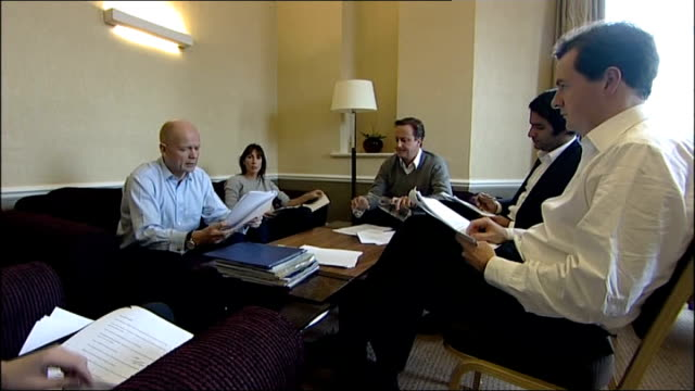 stockvideo's en b-roll-footage met david cameron samantha cameron george osborne mp and william hague mp sitting around table discussing cameron's speech to conservative party... - william hague